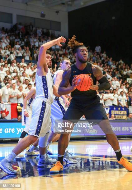Virginia Commonwealth Rams forward Mo AlieCox passes away from George Washington Colonials forward Arnaldo Toro during an Atlantic 10 men's...