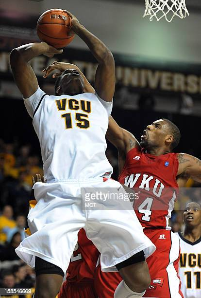 Virginia Commonwealth University forward Juvonte Reddic takes a hard foul from behind from Western Kentucky forward Teeng Akol in the second half at...