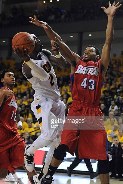 Virginia Commonwealth University guard Briante Weber gets fouled by Dayton guard Vee Sanford on a shot attempt in the second half at the Stuart...