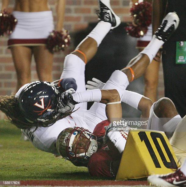 Virginia cornerback Demetrious Nicholson pulls down FSU wide receiver Rashad Greene out of bounds during the Virginia at Florida State University...