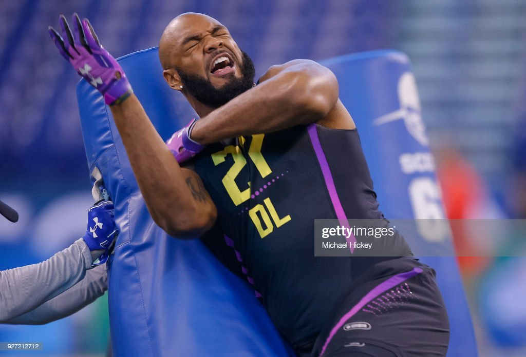 Virginia defensive lineman Drew Brown (DL27) runs thru a drill during the NFL Scouting Combine at Lucas Oil Stadium on March 4, 2018 in Indianapolis, Indiana.