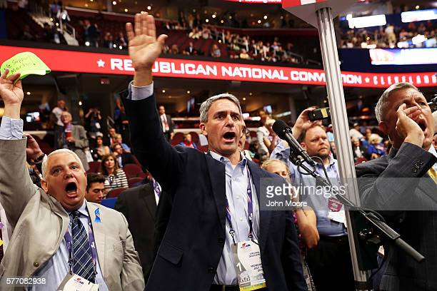 Virginia delegates chant for rules vote on the first day of the Republican National Convention on July 18 2016 at the Quicken Loans Arena in...
