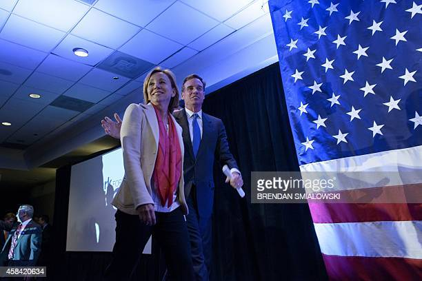 Virginia Democratic Senator Mark Warner and his wife Lisa Collis arrive for an election night rally November 4 2014 in Arlington Virginia Republicans...