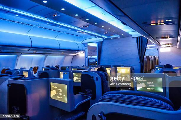 Virginia Dulles International Airport Etihad Airways Business Class cabin low light flight to Abu Dhabi