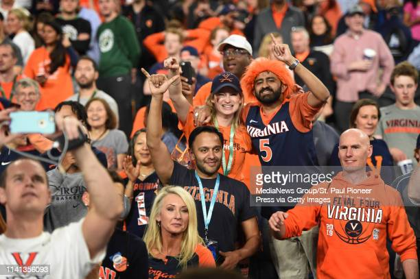 Virginia fans celebrate after their Cavalier team beat the Texas Tech Red Raiders 85-77 to win the championship game of the NCAA Final Four men's...
