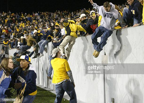 Virginia fans flow from the stands following West Virginia's victory over 3rd ranked Virginia Tech at Mountaineer Stadium Morgantown West Virginia...