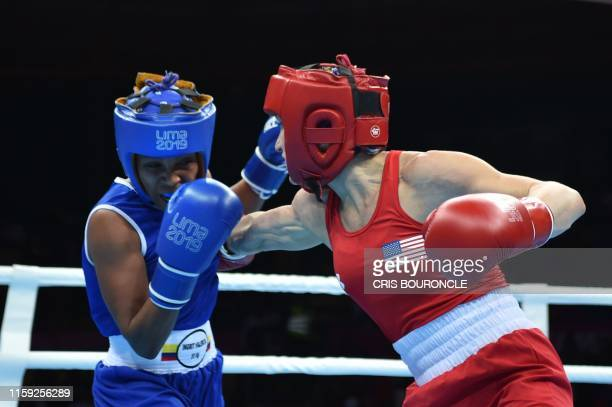 US Virginia Fuchs and Colombia's Ingrit Valencia compete during the Women's Fly Finals Bout of the Boxing competition of the Lima 2019 PanAmerican...