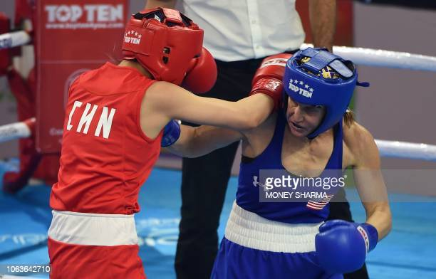 Virginia Fuchs of the US and Chang Yuan of China compete during their 51 kg category quarterfinal fight at the 2018 AIBA Women's World Boxing...