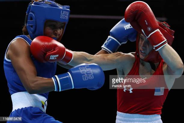 Virginia Fuchs of United States exchanges punches with Ingrit Valencia Victoria of Colombia in Women's Boxing Fly Finals Bout Day 7 of Lima 2019 Pan...