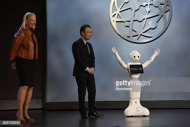 Virginia 'Ginni' Rometty chief executive officer of International Business Machines Corp left and Kenichi Yoshida vice president of business...