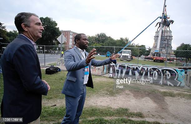 Virginia Gov. Ralph Northam and Richmond Mayor Levar Stoney arrive at the statue of Confederate General Robert E. Lee before it is removed from its...