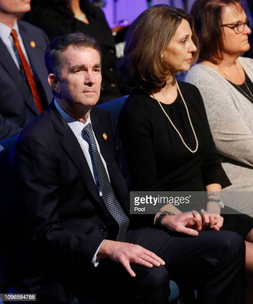 Virginia Gov. Ralph Northam, left, and his wife Pam, wait for the start of the funeral for fallen Virginia State Trooper Lucas B. Dowell at the...