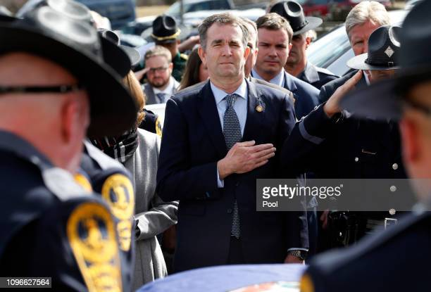 Virginia Gov. Ralph Northam watches as the casket of fallen Virginia State Trooper Lucas B. Dowell is carried to a waiting tactical vehicle during...