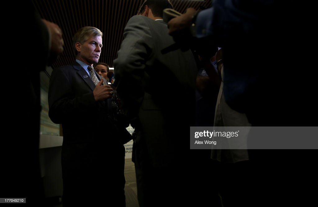Virginia Governor Bob McDonnell answers questions from members of the press after he spoke during an event regarding the launch of the 'Veterans Employment Initiative' August 20, 2013 at ICF International in Fairfax, Virginia. The Northern Virginia Technology Council (NVTC) holds an event to discuss the new program designed to connect veterans to employment opportunities within Virginia's technology community.
