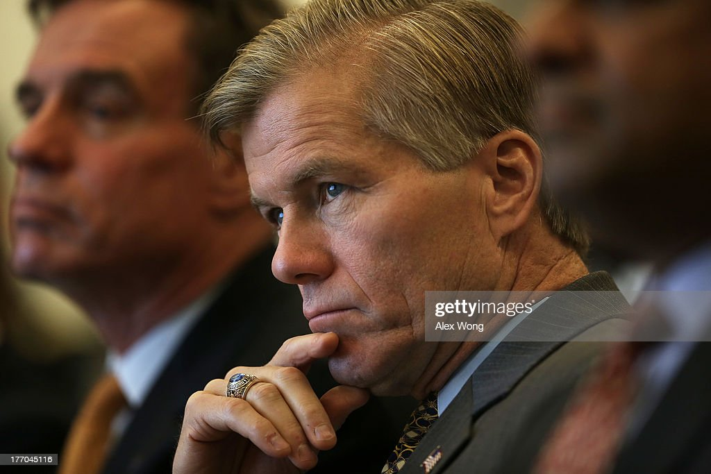 Virginia Governor Bob McDonnell (C) listens during an event regarding the launch of the 'Veterans Employment Initiative' August 20, 2013 at ICF International in Fairfax, Virginia. The Northern Virginia Technology Council (NVTC) holds an event to discuss the new program designed to connect veterans to employment opportunities within Virginia's technology community.