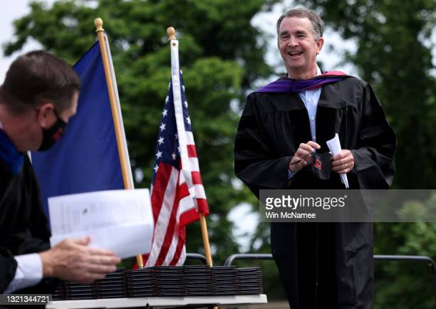 Virginia Governor Ralph Northam concludes his remarks at George Mason High School's graduation ceremony June 2, 2021 in Falls Church, Virginia. Today...