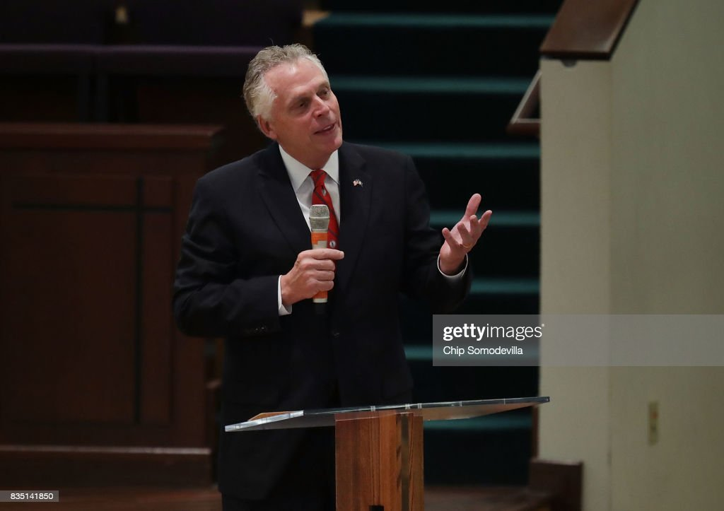 Virginia Governor Terry McAuliffe delivers remarks during the funeral for Trooper-Pilot Berke M.M. Bates at Saint Paul's Baptist Church August 18, 2017 in Richmond, Virginia. Bates and Lieutenant Pilot Jay Cullen were killed when their Bell 407 helicopter crashed into a wooded area while they were monitoring the civil unrest during the white supremacy 'Unite the Right' rally August 12 in Charlottesville, VA.