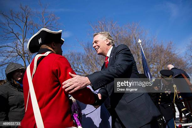 Virginia Governor Terry McAuliffe shakes hands with Mount Vernon reenactor Don Francisco after making remarks during the Official Observance of...