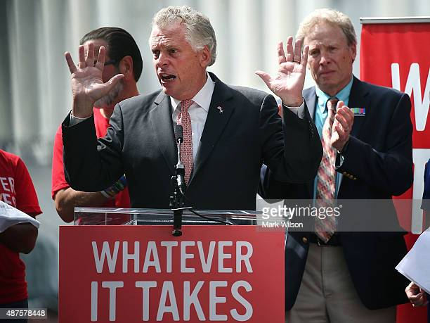 Virginia Governor Terry McAuliffe speaks while flanked by Andy Parker father of murdered TV reporter Alison Parker during a anti gun rally on Capitol...