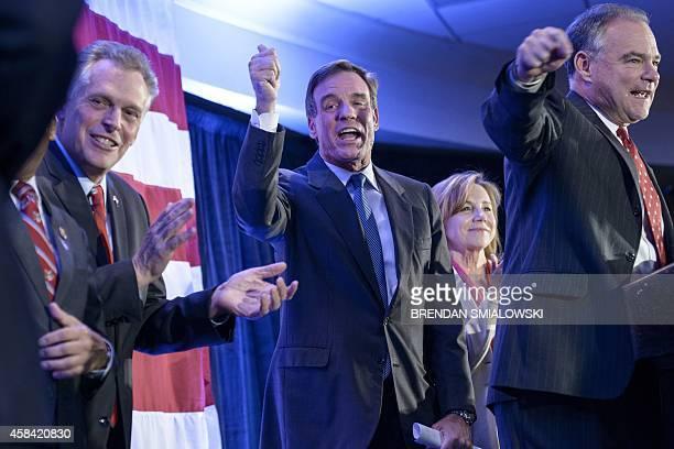 Virginia Governor Terry McAuliffe Virginia Senator Mark Warner C his wife Lisa Collis and Virginia Senator Tim Kaine cheer during an election night...