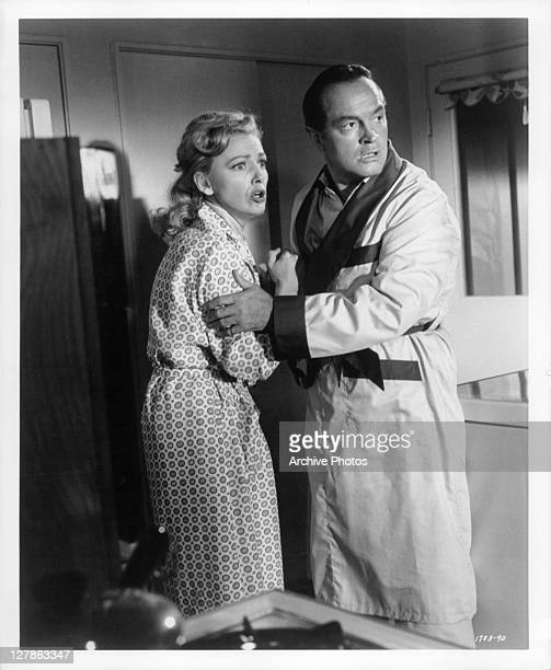 Virginia Grey informs Bob Hope that her husband is on the way in a scene from the film 'Bachelor In Paradise' 1961