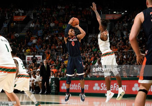 Virginia guard Devon Hall shoots against Miami guard Lonnie Walker IV during a college basketball game between the University of Virginia Cavaliers...