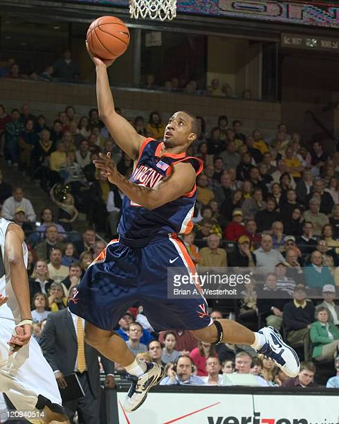 Virginia guard JR Reynolds glides to the basket for 2 of his 15 points during second half action versus Wake Forest at the LJVM Coliseum in...