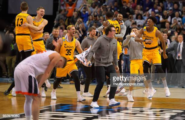 Virginia guard Kyle Guy left reacts to UMBC celebrating as UMBC upsets the University of Virginia in the 1st round for the mens NCAA basketball...