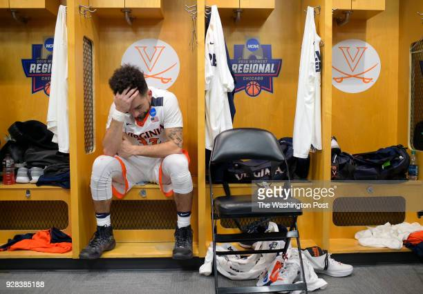 Virginia guard London Perrantes sits in the locker room after Syracuse defeats Virginia 68 62 to win the Midwest regional final in the Men's NCAA...
