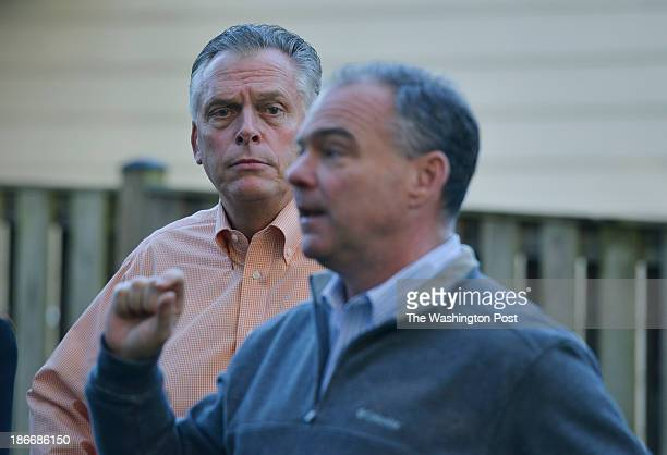 Virginia gubernatorial candidate Terry McAuliffe, L, listens to Virginia Senator Tim Kaine speak on his behalf at the home of supporter Ray Smith,...