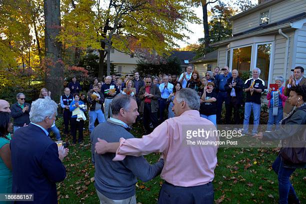Virginia gubernatorial candidate Terry McAuliffe, R, acknowledges Virginia Senator Tim Kaine, C, at the home of supporter Ray Smith, where volunteers...