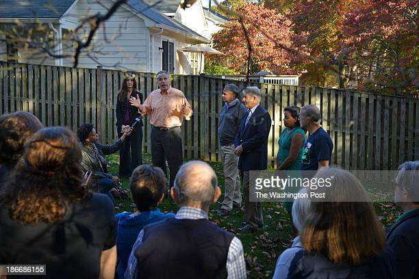 Virginia gubernatorial candidate Terry McAuliffe standing alongside Virginia Senator Tim Kaine and attorney general candidate Senator Mark Herring...