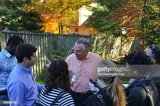 Virginia gubernatorial candidate Terry McAuliffe talks with some of his staff and reporters after an appearance with attorney general candidate...