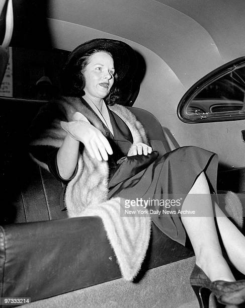 Virginia Hill in a cab after ordeal with senators and the press in connection with her appearance at the crime investigating committee hearing in the...