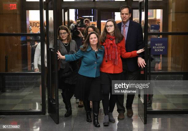 Virginia House of Delegates candidate Shelly Simonds accompanied by her daughter Georgia Danehy and her husband Paul Danehy leaves a meeting of the...