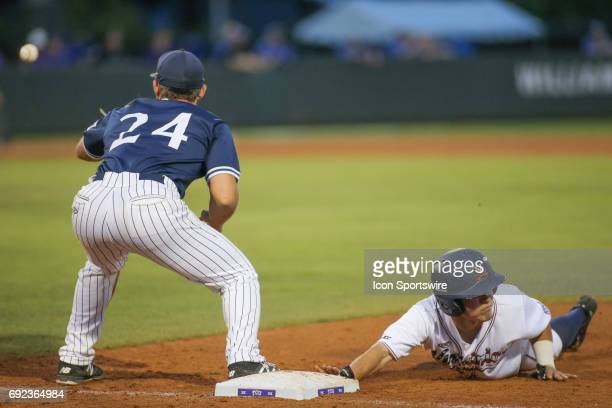 Virginia infielder Ernie Clement dives to avoid a pickoff tag by Dallas Baptist first baseman Austin Listi during the NCAA Division 1 baseball...