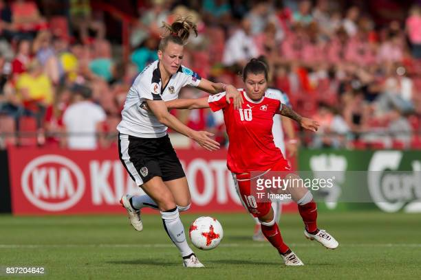 Virginia Kirchberger of Austria and Ramona Bachmann of Switzerland battle for the ball during the Group C match between Austria and Switzerland...