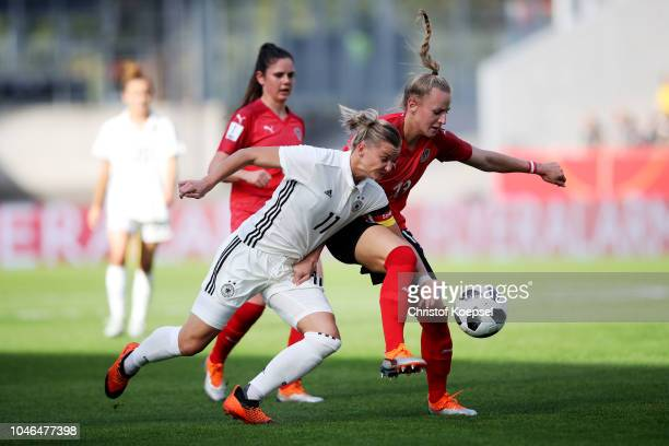 Virginia Kirchberger of Austria challenges Alexandra Popp of Germany during the International friendly match between Germany Women and Austria Women...