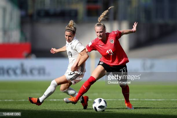 Virginia Kirchberger of Austria challenges Svenja Huth of Germany during the International friendly match between Germany Women and Austria Women at...
