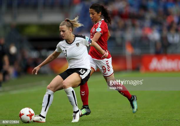 Virginia Kirchberger of Austria holds off pressure from Nadia Nadim of Denmark during the UEFA Women's Euro 2017 Semi Final match between Denmark and...