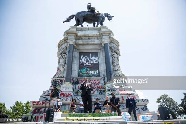 Virginia Lieutenant Gov. Justin Fairfax speaks to demonstrators in front of a statue of Confederate General Robert E. Lee is pictured on June 4, 2020...