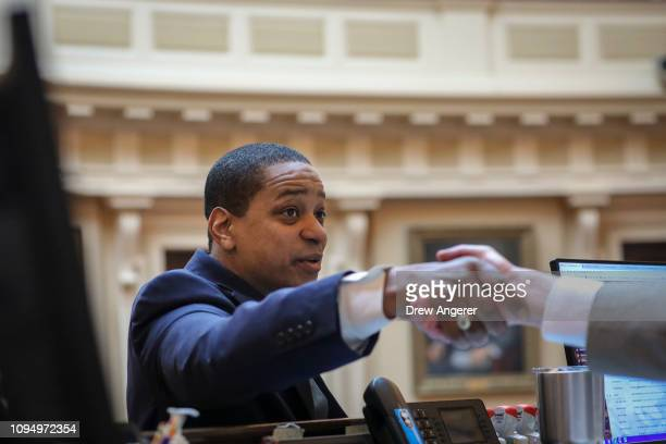 Virginia Lt Governor Justin Fairfax shakes hands as he arrives in the Senate chamber at the Virginia State Capitol February 7 2019 in Richmond...