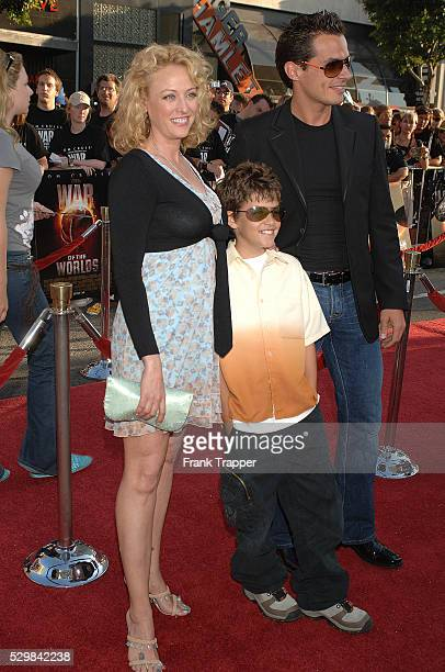 Virginia Madsen and Antonio Sabato Jr arrive with their son Jake at the special fan premiere of 'War of the Worlds' held at the Chinese Theater in...