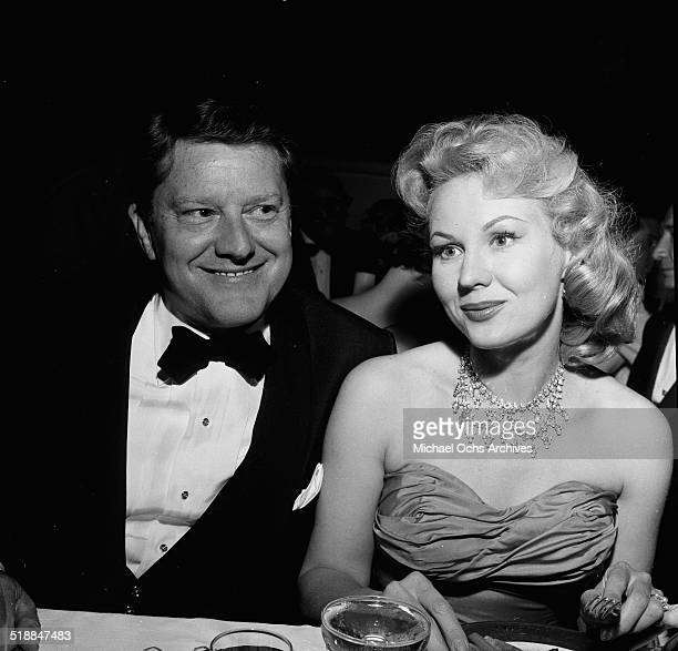 Virginia Mayo and husband Michael O'Shea attends a party in Los AngelesCA