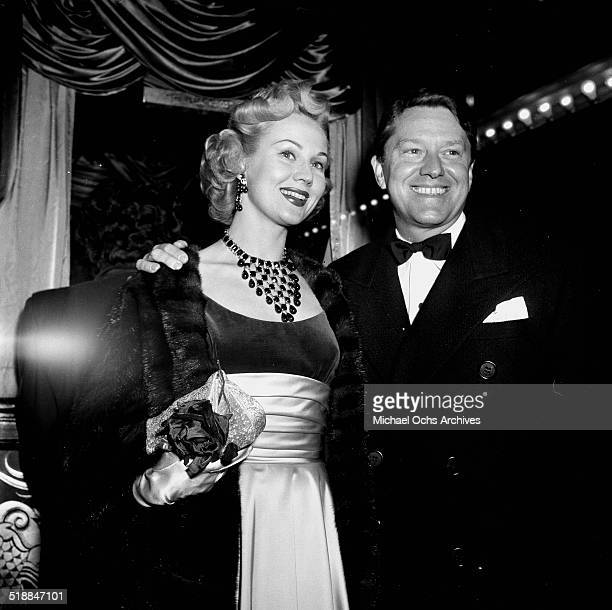 Virginia Mayo and husband Michael O'Shea attends a premiere in Los AngelesCA