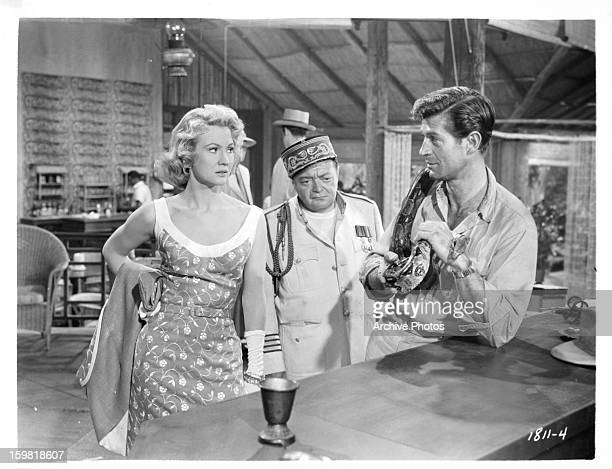 Virginia Mayo Peter Lorre and George Nader in a scene from the film 'Congo Crossing' 1956