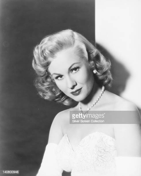 Virginia Mayo US actress wearing white shoulderless dress with a diamond necklace in a studio portrait circa 1950