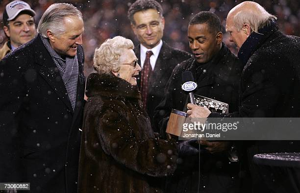 Virginia McCaskey team owner of the Chicago Bears and her son Michael McCaskey receive the George S Halas trophy from Hall of Fame running back Tony...