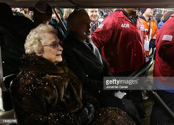 Virginia McCaskey team owner of the Chicago Bears is seen on a golf cart with her son Michael McCaskey on the field as they await the presentation of...