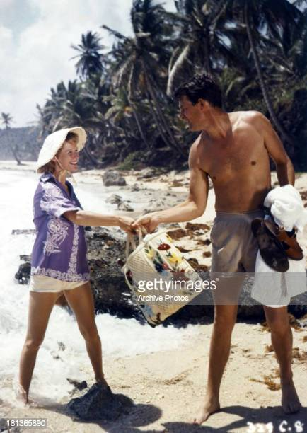 Virginia McKenna is helped by a man in a scene from the film 'Storm Over Jamaica' 1958